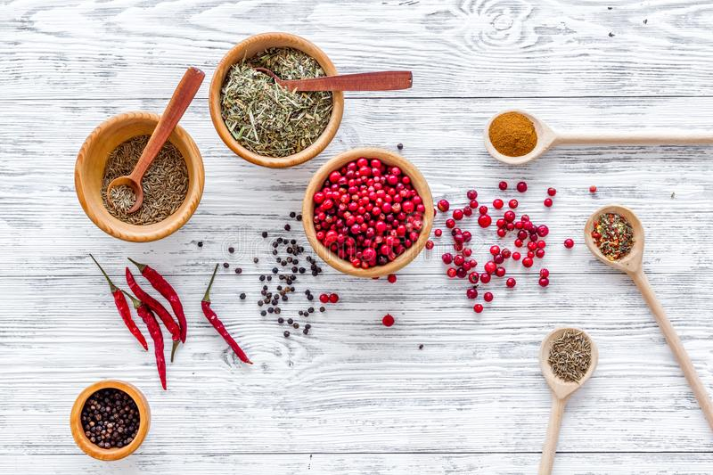 Spicy food cooking with spices and dry herbs light wooden kitchen desk background top view pattern stock photography