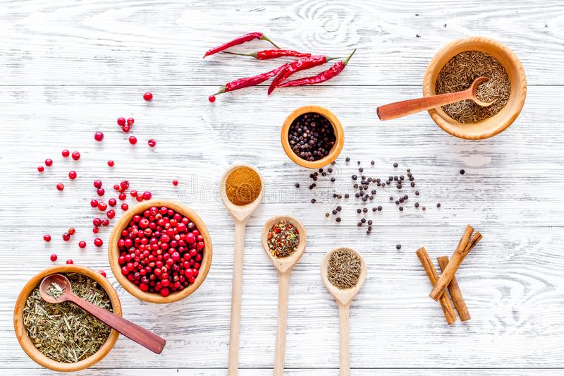 Spicy food cooking with spices and dry herbs light wooden kitchen desk background top view pattern royalty free stock photos