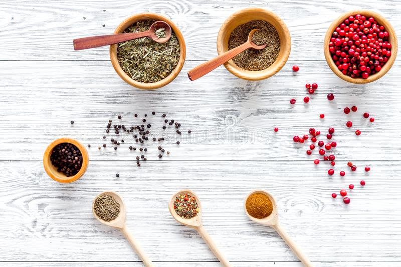 Spicy food cooking with spices and dry herbs light wooden kitchen desk background top view pattern stock images