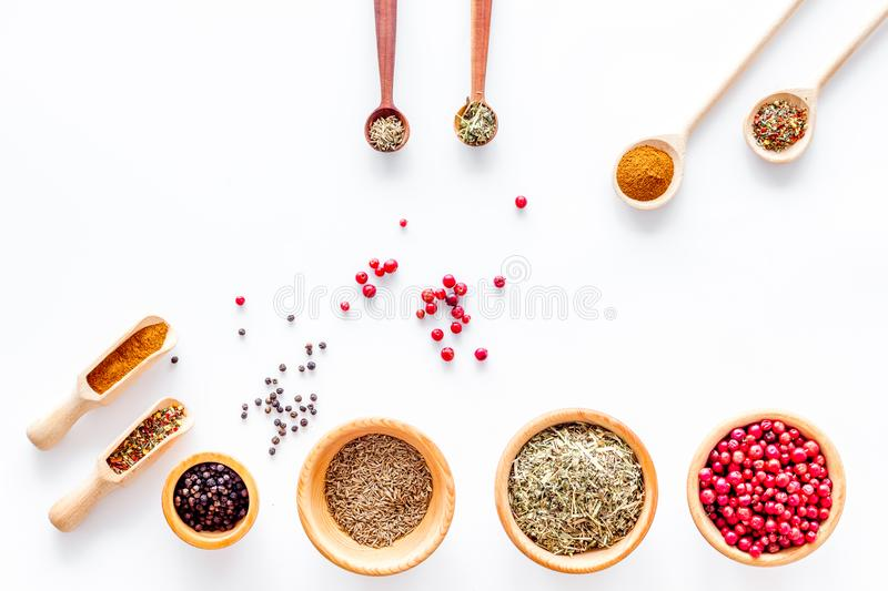 Spicy food cooking with spices and dry herbs white kitchen desk background top view mock up royalty free stock photos
