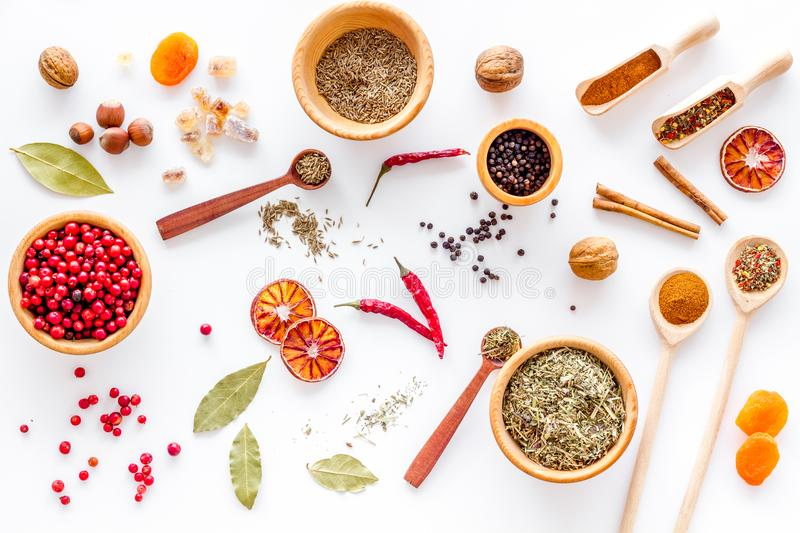 Spicy food cooking with spices and dry herbs white kitchen desk background top view pattern. Spicy food cooking with spices and dry herbs on white kitchen desk stock image
