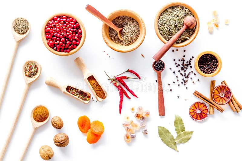Spicy food cooking with spices and dry herbs white kitchen desk background top view pattern royalty free stock photos