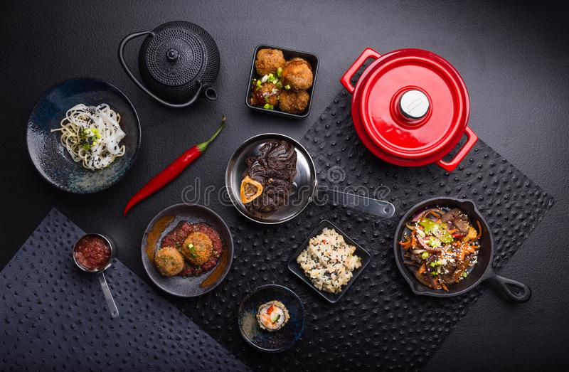Spicy food top view setting, black background stock photography
