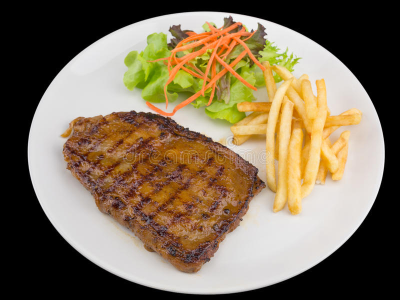 Spicy Grilled chicken steak served with french fries and salads stock photography