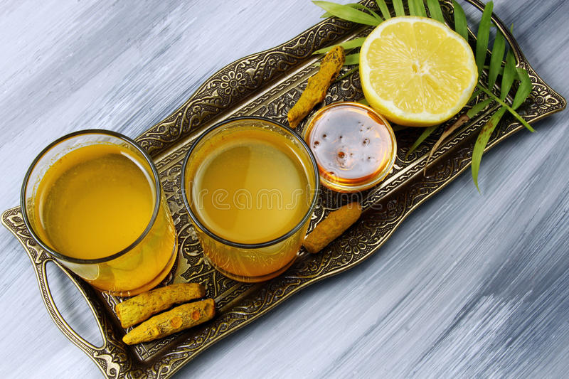 Spicy healthy Haldi or Turmeric, lemon. royalty free stock photography