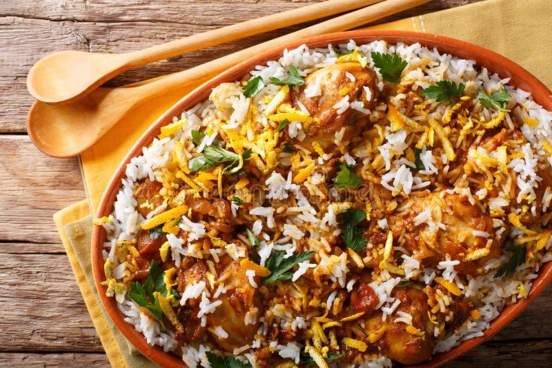 Spicy hot chicken dum biryani close-up in dish. horizontal top v royalty free stock photography