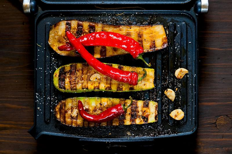 Spicy hot grilled zucchini and eggplant, cooked on an electric grill. Banner. The concept of healthy eating and delicious food. royalty free stock photos