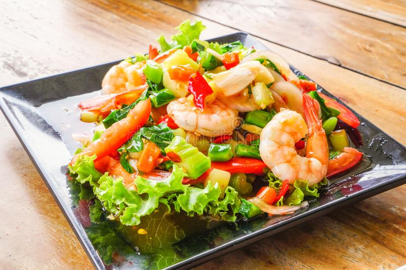 Spicy Kale Branch with Shrimp Salad on the black dish. 2. Spicy Kale Branch with Shrimp Salad on the black dish. Thai spicy food.2 stock photo
