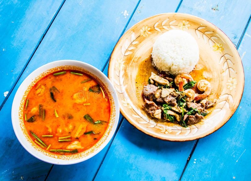 Spicy lemongrass soup and stir-fried shrimp and pork with ric.  royalty free stock photography