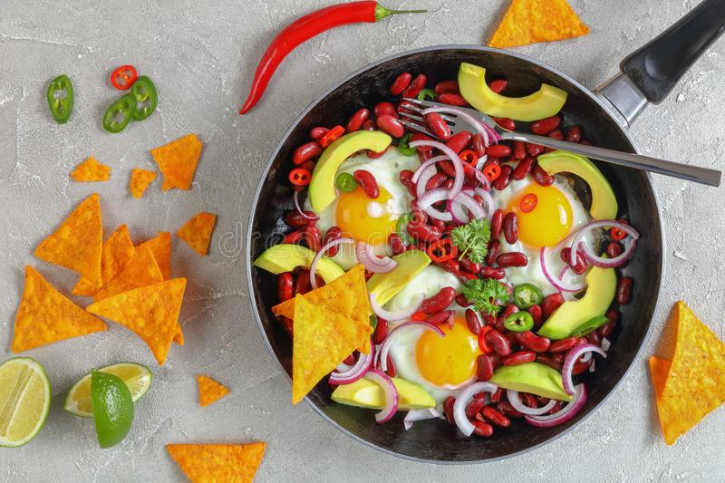 Spicy mexican breakfast on a skillet stock image