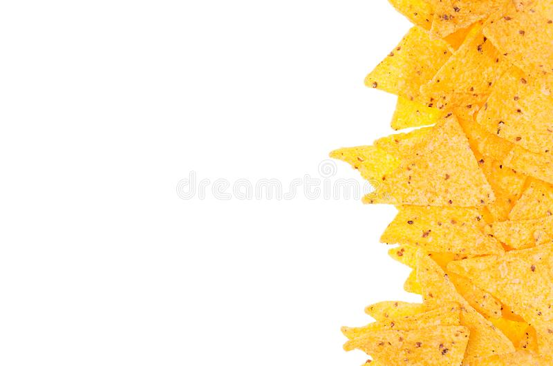 Spicy nachos as decorative food border isolated on white background. Top view, copy space. Spicy nachos as decorative food border isolated on white background royalty free stock image
