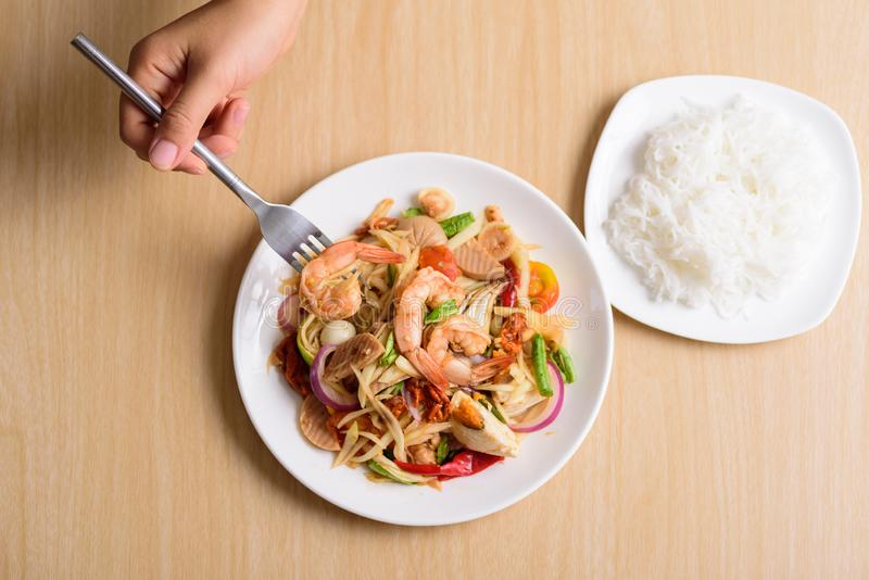 Spicy papaya salad with prawn and rice noodles royalty free stock images