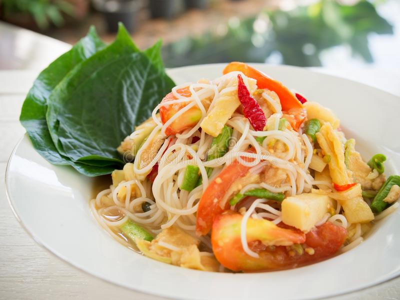 Spicy papaya salad with rice noodle or somtum famous traditiona stock photo
