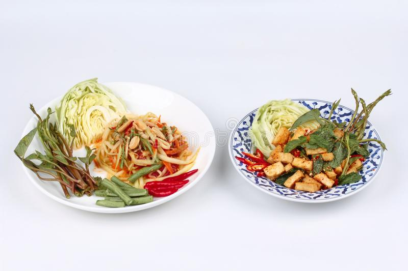 Spicy papaya salad and Spicy sour mixed herb salad with fried to. Fu for Chinese vegetable festival royalty free stock images