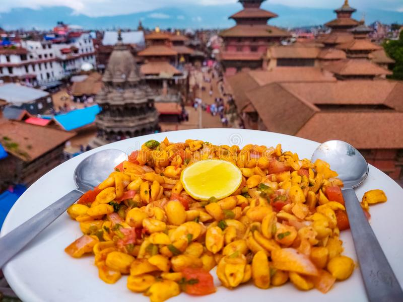 Spicy peanuts with Patan Durbar Square in the background stock photos