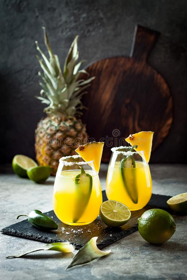 Spicy pineapple margarita cocktail with jalapeno and lime. Mexican alcoholic drink for Cinco de mayo party. Spicy pineapple margarita cocktail with jalapeno and royalty free stock photos