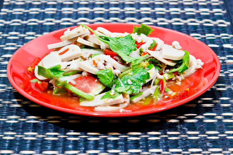 Spicy pork salad with vegetables. On table royalty free stock images
