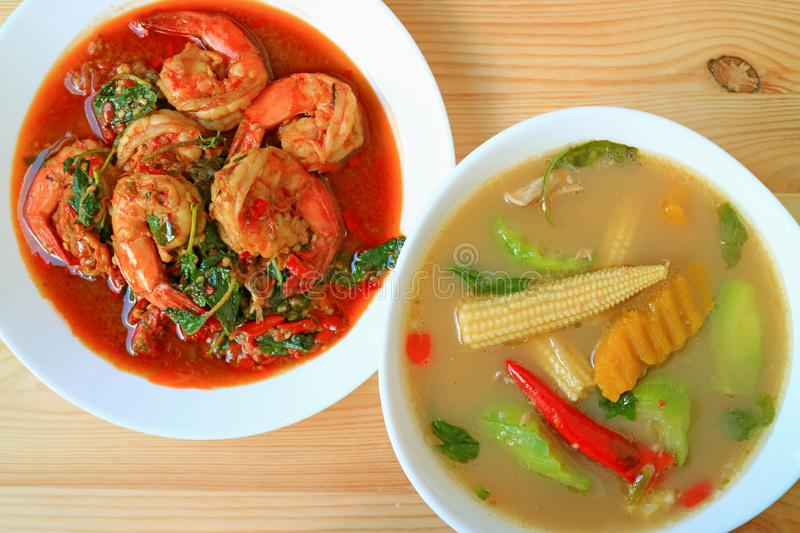 Spicy Prawns Stir Fried with Holy Basil and Spicy Mixed Vegetable Soup, Popular Healthy Thai Dishes. Background asian baby beige bowl chili cooking corn royalty free stock photos