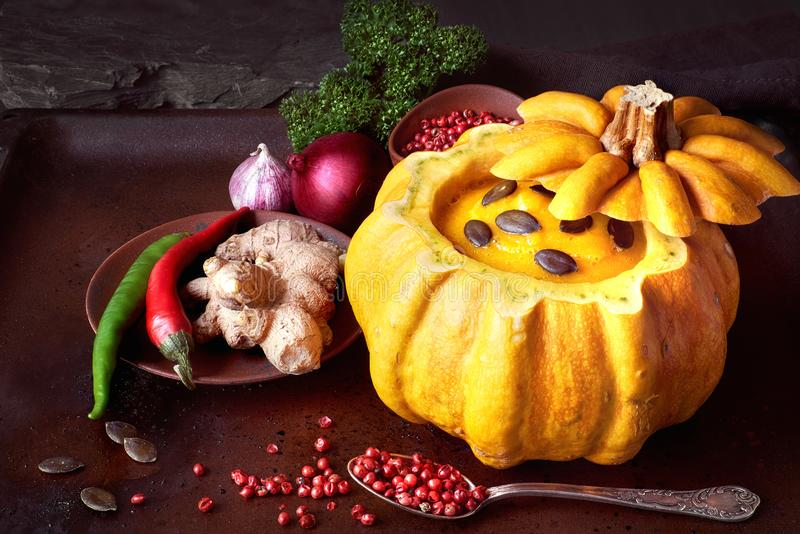 Download Spicy Pumpkin Soup Served In A Hollowed Pumpin On Dark Backgroun Stock Image - Image: 102199043