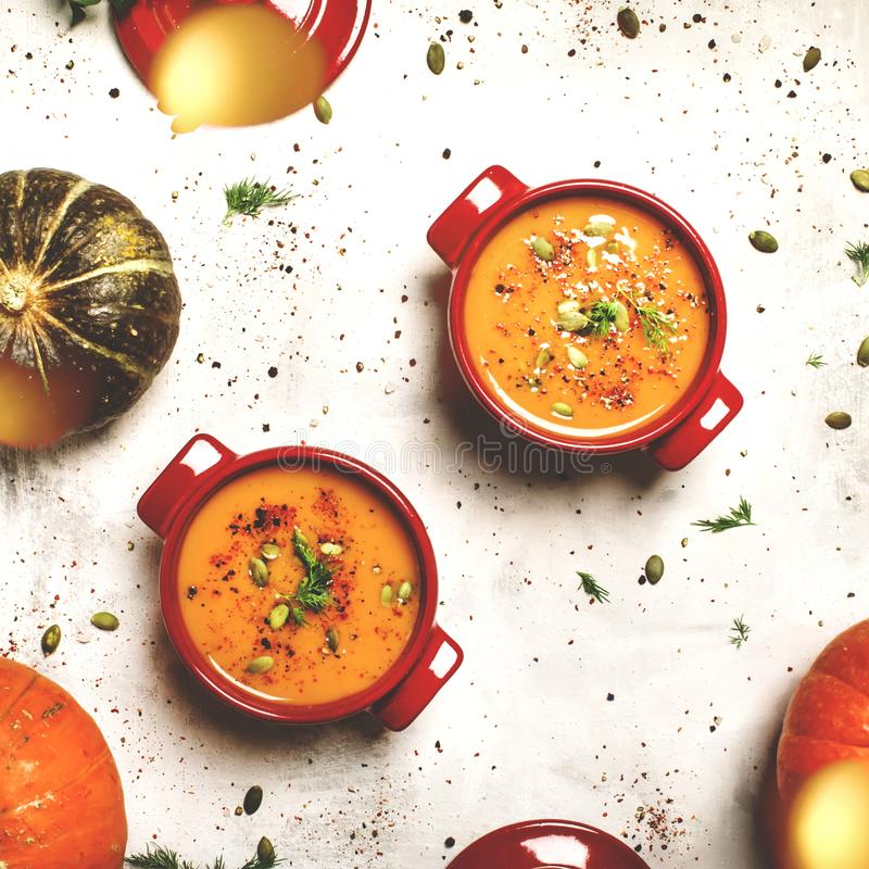 Spicy pumpkin soup in a serving pan, top view. Spicy pumpkin soup in a red serving pan, top view stock photos