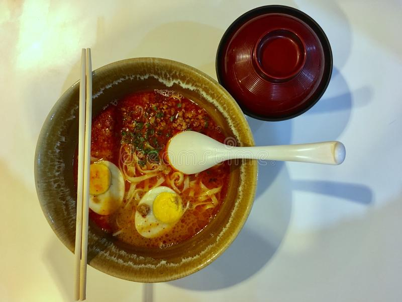Spicy ramen noodle with boiled egg stock photo