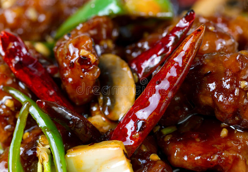 Spicy red hot Chile peppers with chicken and vegetables dish royalty free stock photo