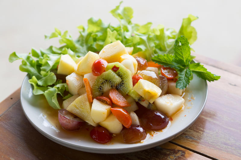 Spicy salad mixed fruit stock photography