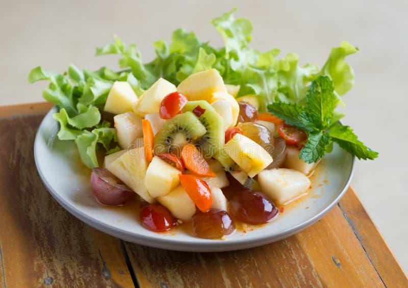Spicy salad mixed fruit stock photo