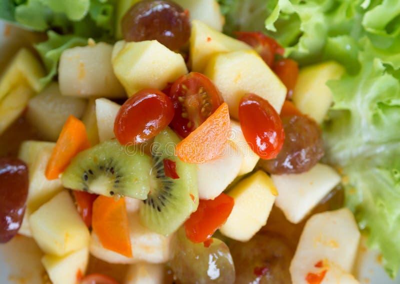 Spicy salad mixed fruit stock photos