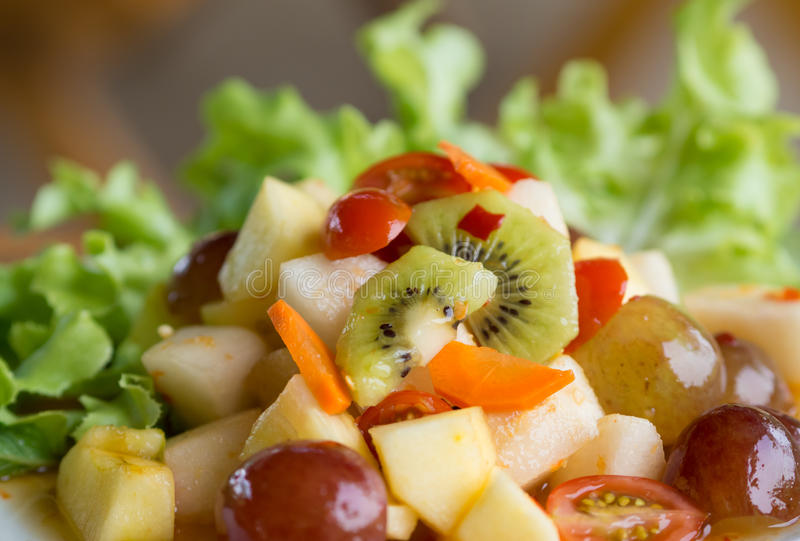 Spicy salad mixed fruit stock images