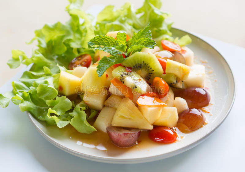 Spicy salad mixed fruit stock image