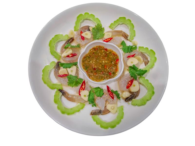 Spicy salad with raw shrimp in fish sauce and garlic isolate on white background with clipping path.Kung Chae Nampla stock image
