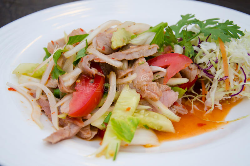 Spicy salad with Roasted pork stock images