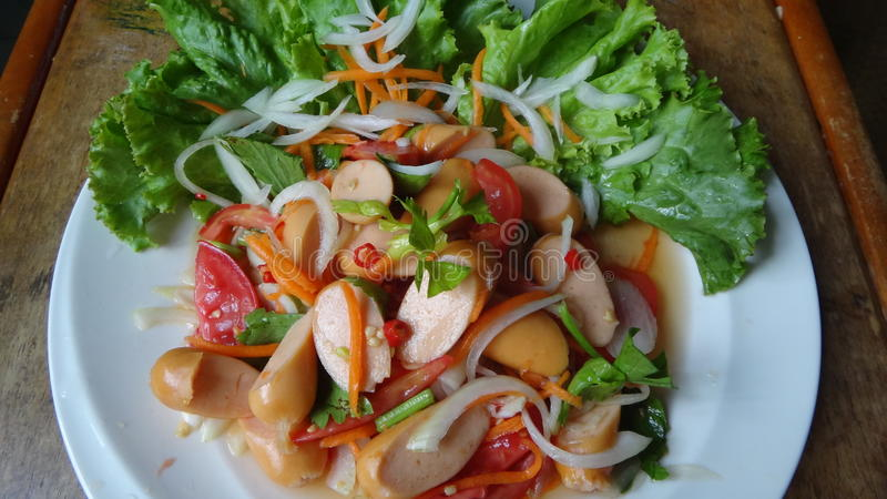 Spicy sausages salad. And vegetables royalty free stock photography