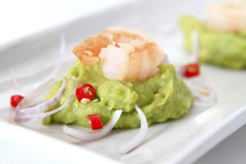Spicy Shrimp Guacamole. With red chili and onion royalty free stock photos