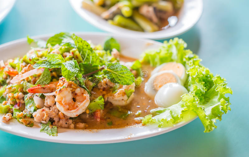 Spicy shrimp Salad Flavored and boiled egg stock photography