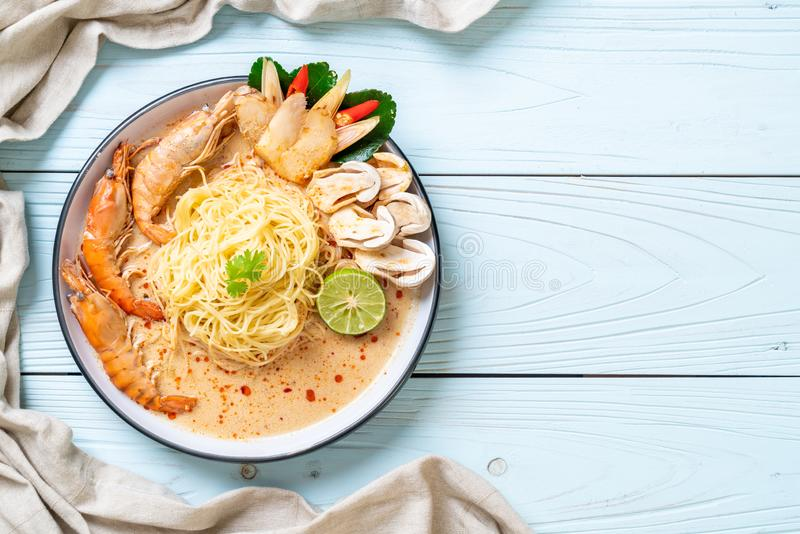 Spicy shrimps spaghetti pasta (Tom Yum Goong. ) - Italian fusion food style royalty free stock photography