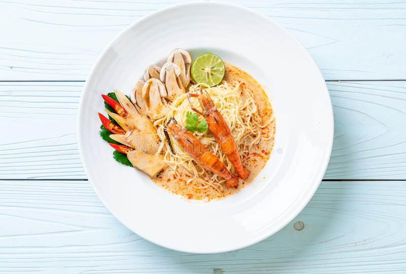 Spicy shrimps spaghetti pasta (Tom Yum Goong. ) - Italian fusion food style royalty free stock images