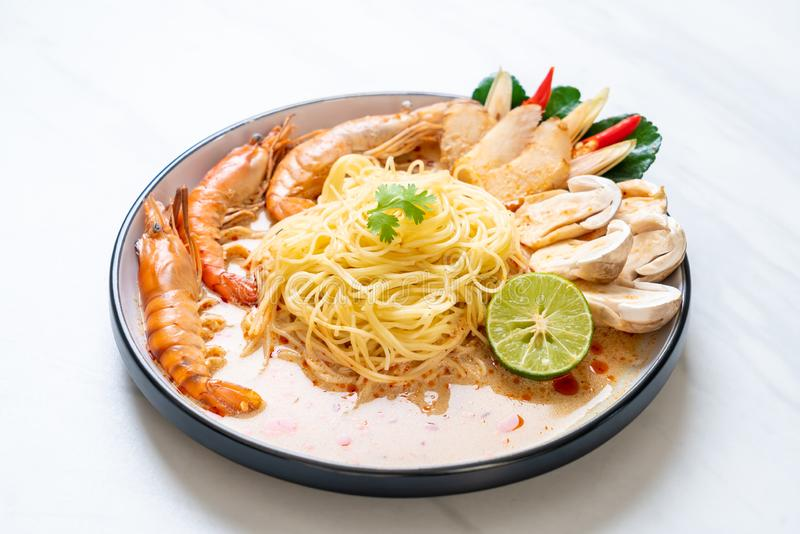Spicy shrimps spaghetti pasta (Tom Yum Goong. ) - Italian fusion food style stock image
