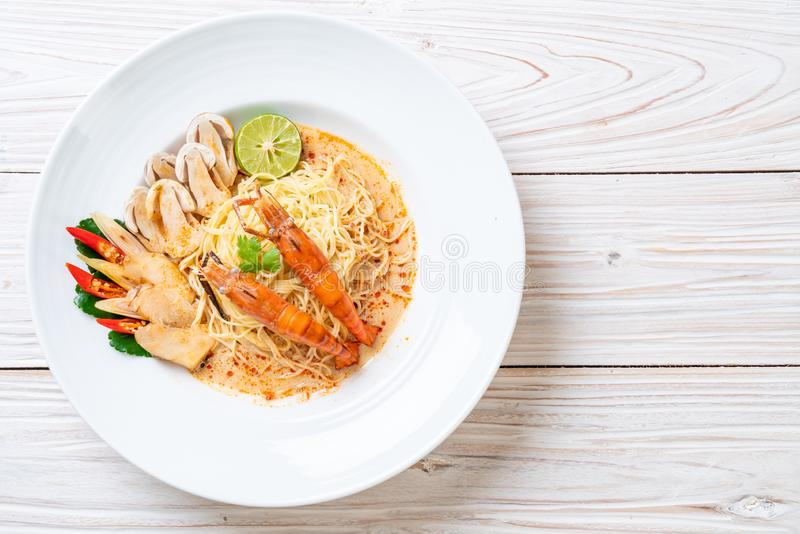 Spicy shrimps spaghetti pasta (Tom Yum Goong. ) - Italian fusion food style stock photography