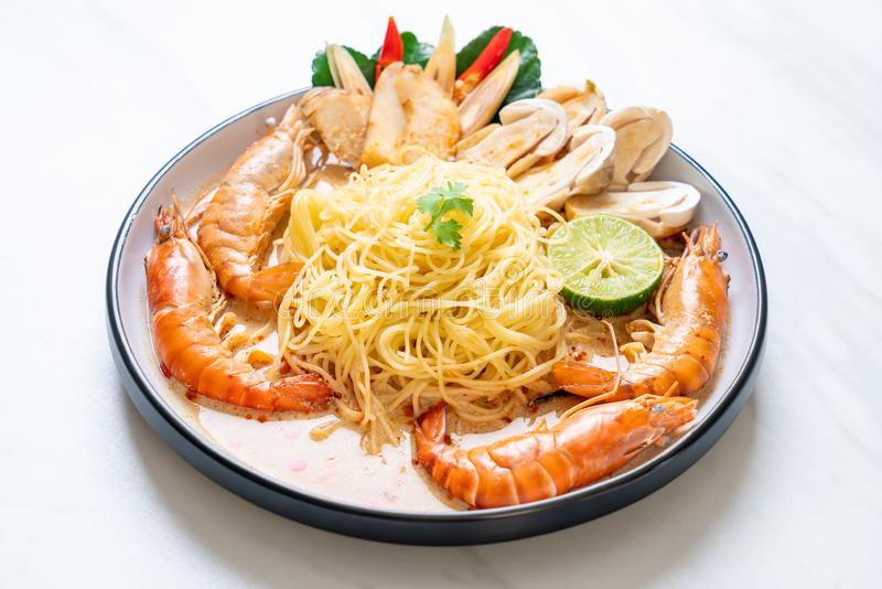 Spicy shrimps spaghetti pasta (Tom Yum Goong. ) - Italian fusion food style stock images