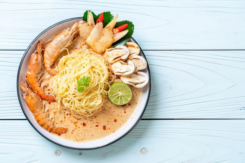 Spicy shrimps spaghetti pasta (Tom Yum Goong. ) - Italian fusion food style royalty free stock image