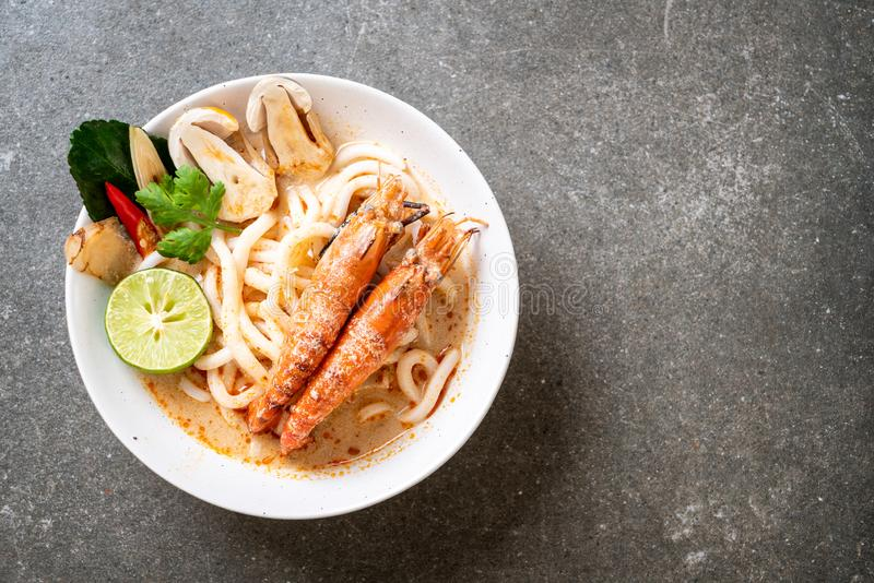 Spicy shrimps udon ramen noodle (Tom Yum Goong. ) - japanese fusion food style stock photos
