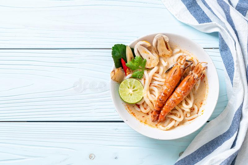 Spicy shrimps udon ramen noodle (Tom Yum Goong. ) - japanese fusion food style royalty free stock image