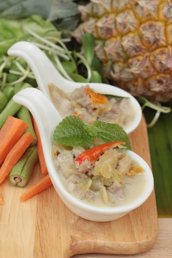 Spicy simmer pineapple with pork and vegetables. stock image