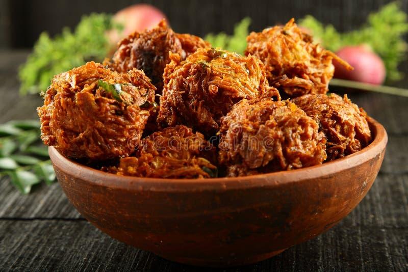 Spicy snack onion fritters. Indian street snack onion pakoda stock photo