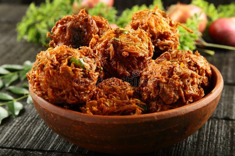 Spicy snack onion pkkora. Indian street snack onion pakoda royalty free stock photos