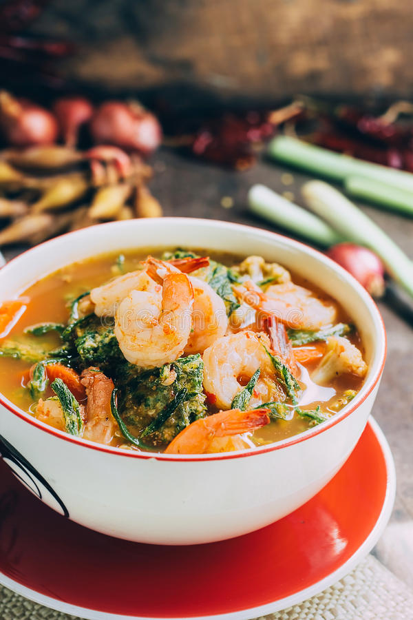 Spicy and Soup Curry with Shrimp and Vegetable Omelet. Hot and sour curry with tamarind sauce, shrimp and vegetables : Delicious thai traditional food (kang som stock photography