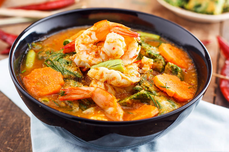 Spicy and Soup Curry with Shrimp and Vegetable Omelet. Hot and sour curry with tamarind sauce, shrimp and vegetables : Delicious thai traditional food (kang som stock images