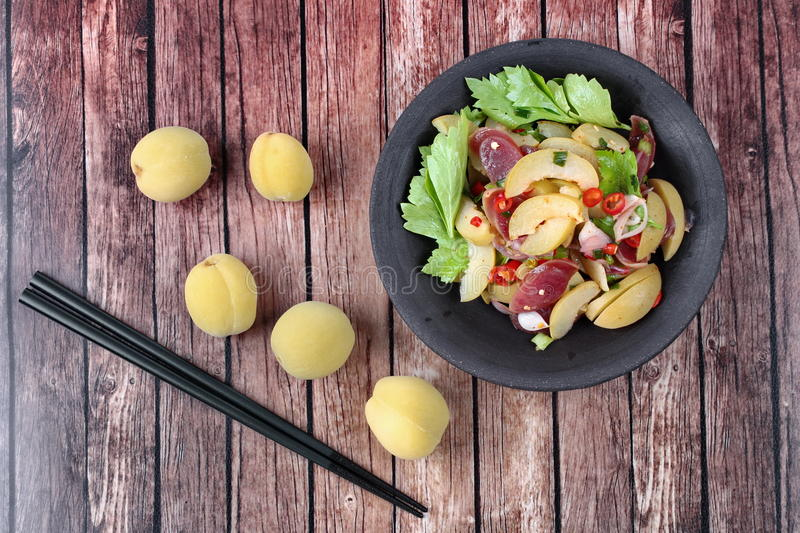 Spicy sour Chinese sausage salad with Peach honey - compote . Thai food , Spicy sour Chinese sausage salad with Peach compote and whole of Peach compote with stock image